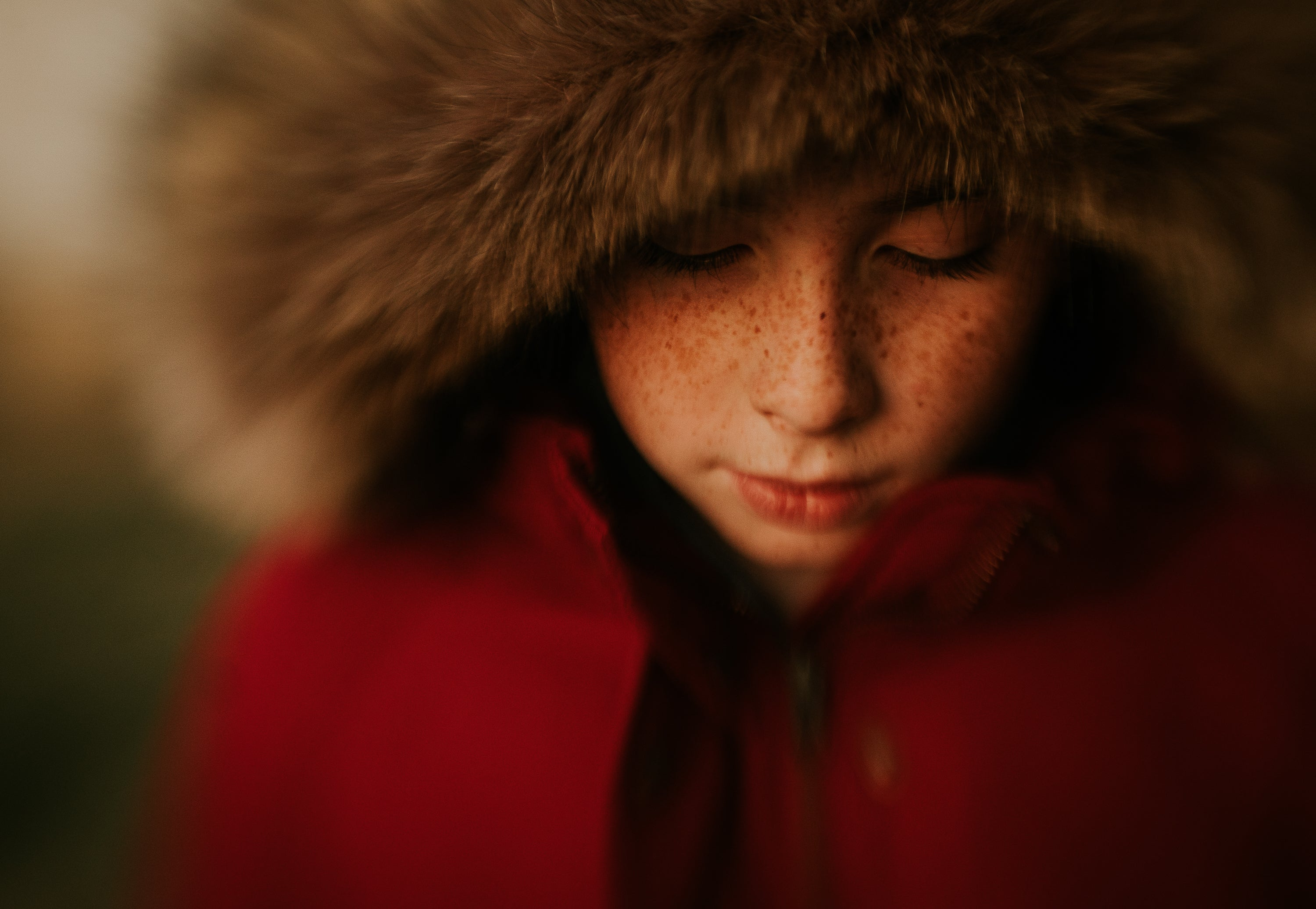 boy with freckles and red lips in red jacket with fur journey story amy cyphers