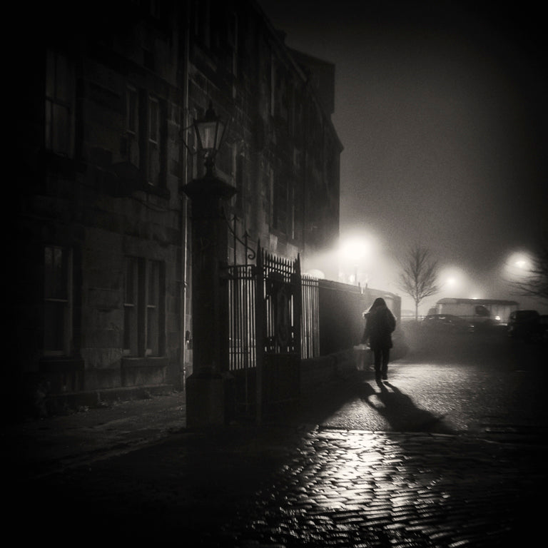 night street lights buildings person fog mystery black and white Lensbaby Featured Photos