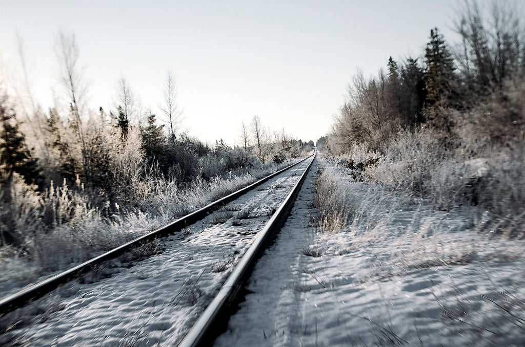 snow on railroad tracks winter blue sky landscape photography Lensbaby featured photos