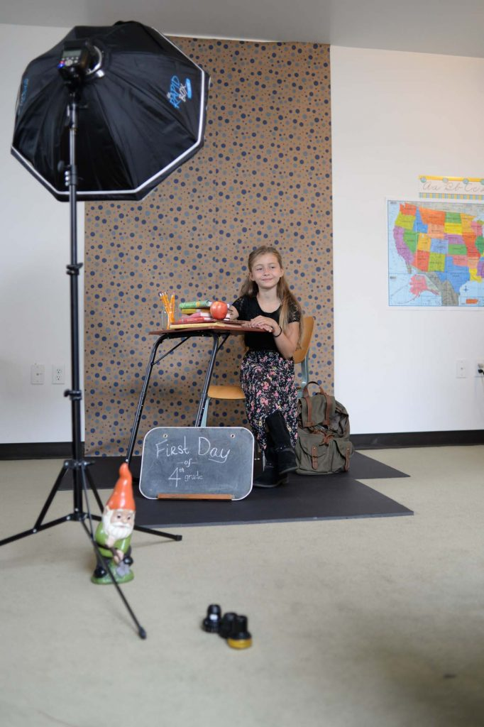 Back to school photo setup with backdrop and lights