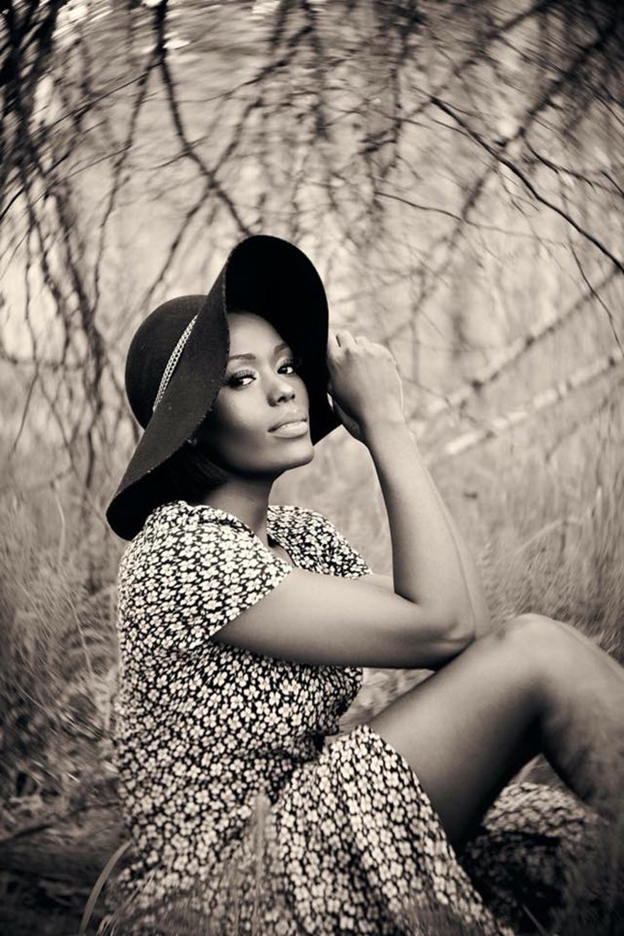 woman with black floppy fashion hat and black and white dress featured photos lensbaby
