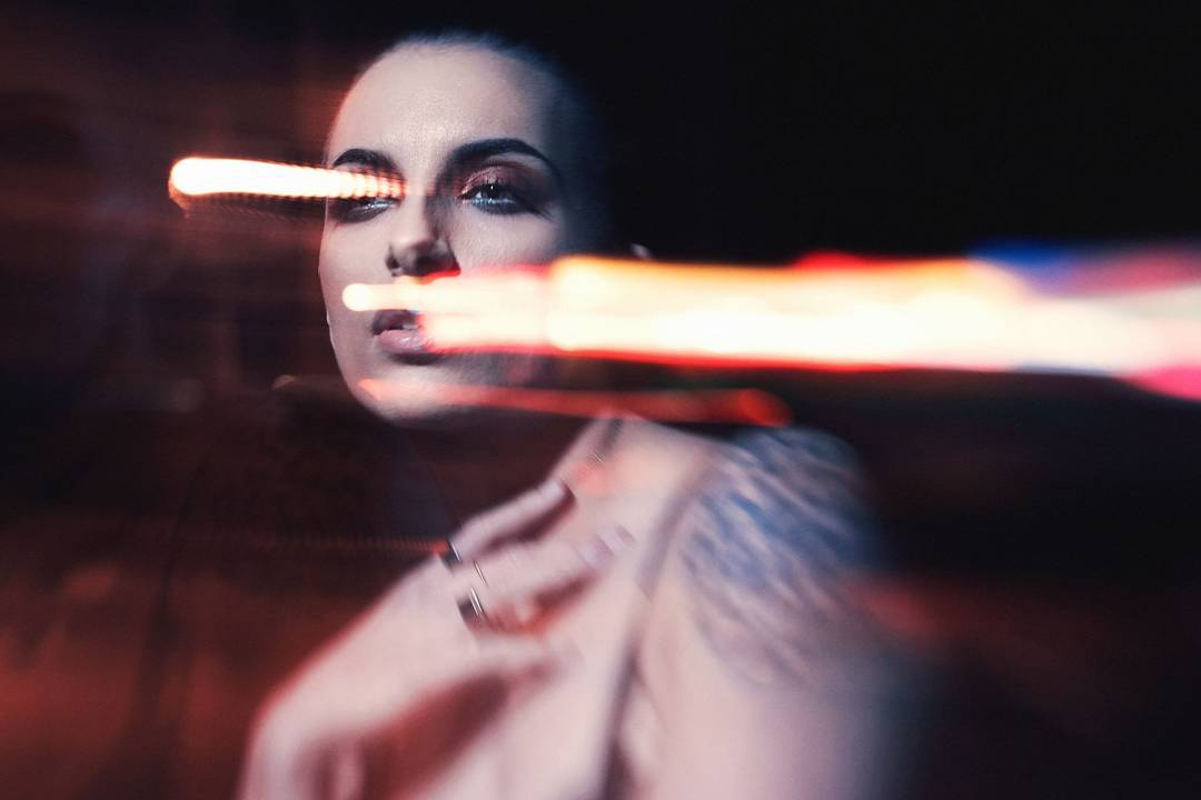 Woman staring into the distance with dark makeup mystery flashes of light featured photos of the week