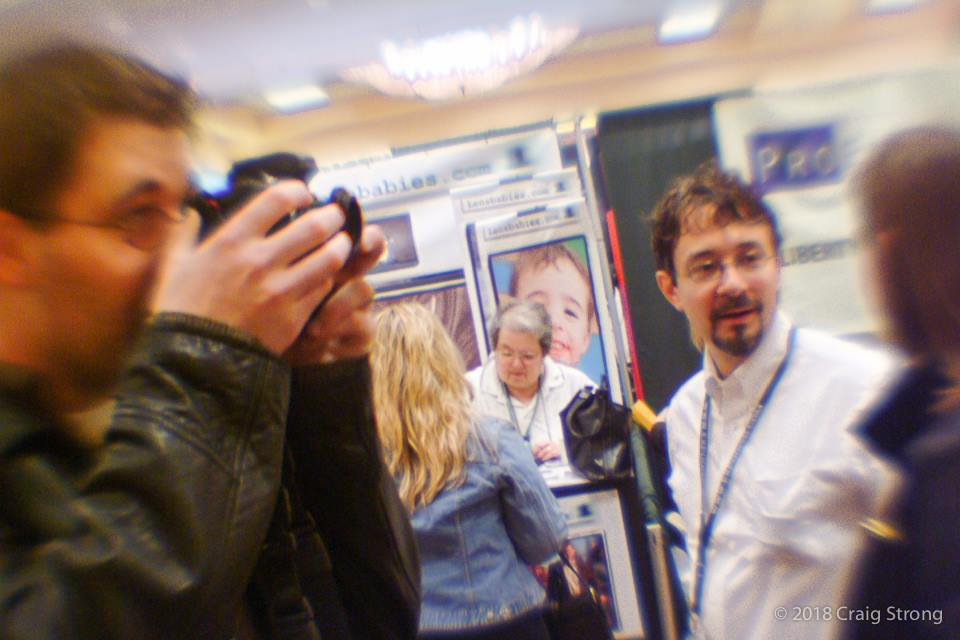 camera tradeshow people taking photos selective focus Lensbaby history craig strong WPPI