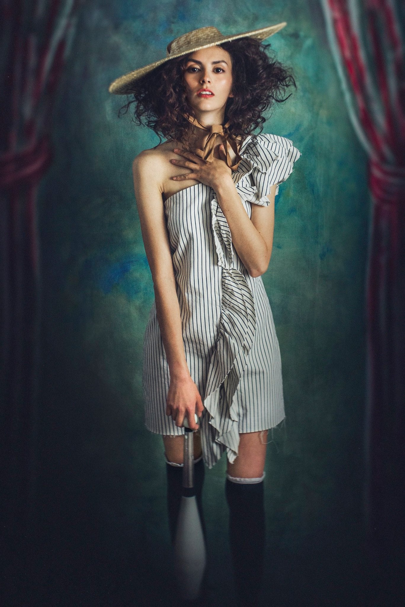woman with striped romper big straw hat curly brown hair dark red lipstick tall socks and skinny legs Lensbaby featured photos