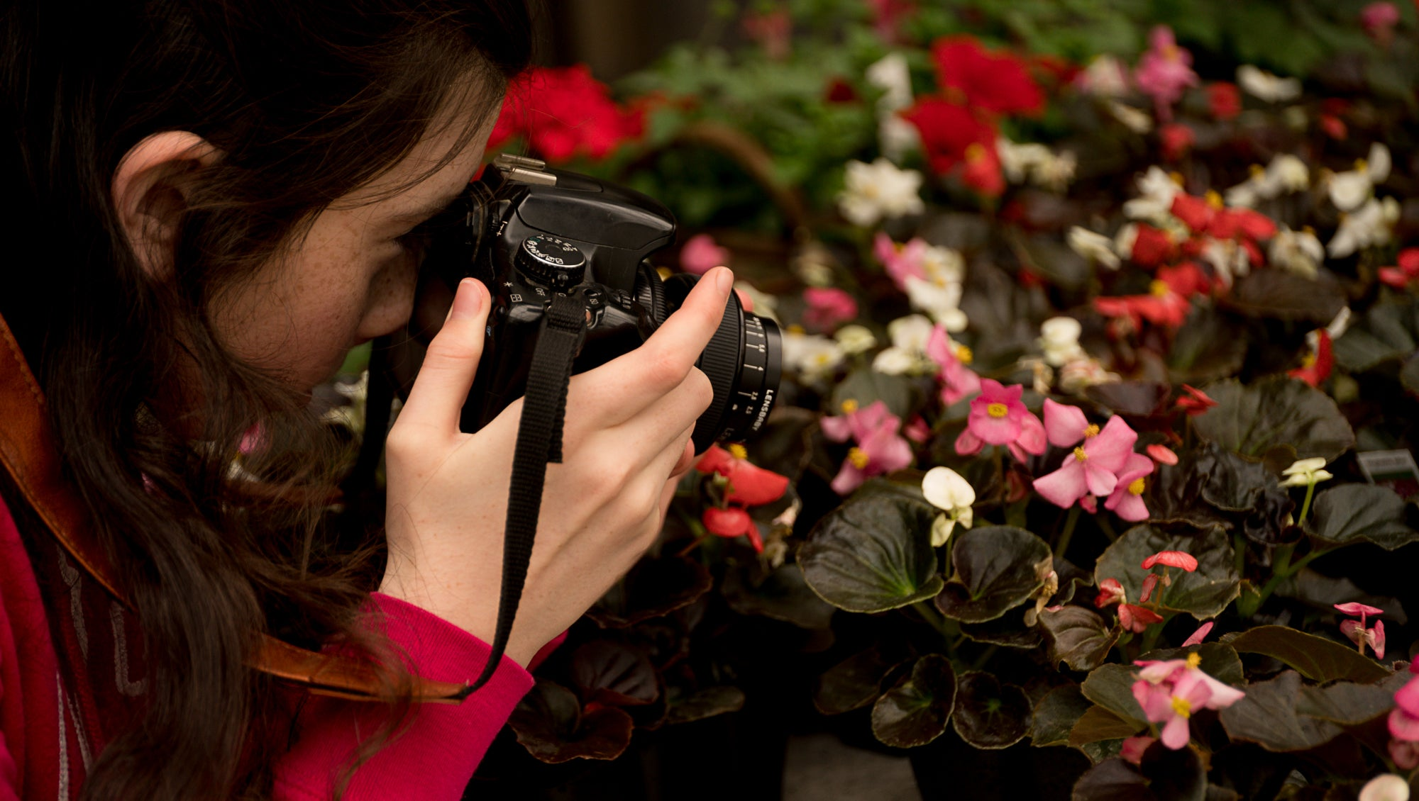 girl taking photos of flowers pink white and red photos Amy Cyphers Photography Adventures