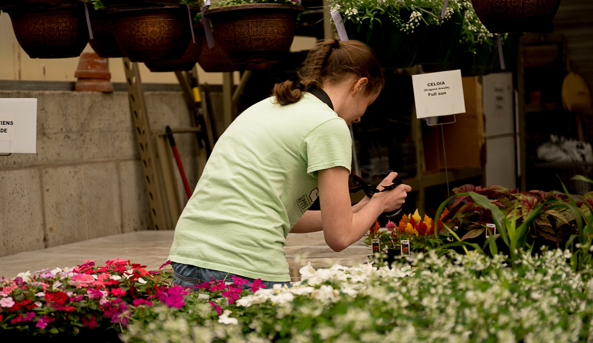 girl in green shirt taking photos of flowers Lensbaby Amy Cyphers Photography Adventures