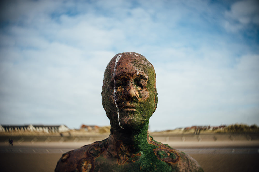 iron statue by the beach black and white Anthony Gormley's Another Place UK beach janet broughton Burnside 35
