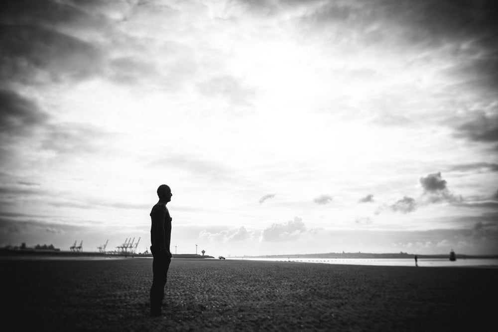 silhouette person by the beach black and white Anthony Gormley's Another Place UK beach janet broughton Burnside 35