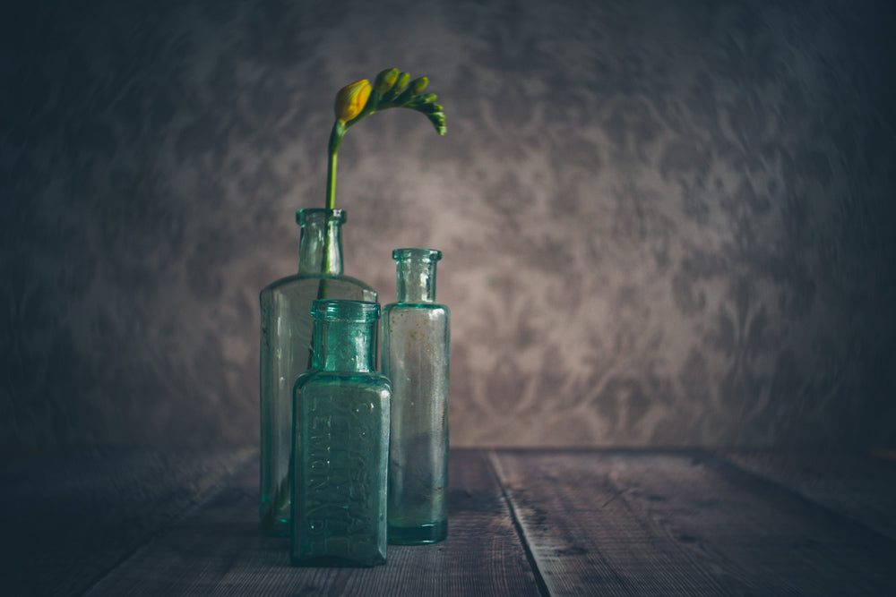 old green jars as vases white flowers tall yellow flowers Janet Broughton Still Life