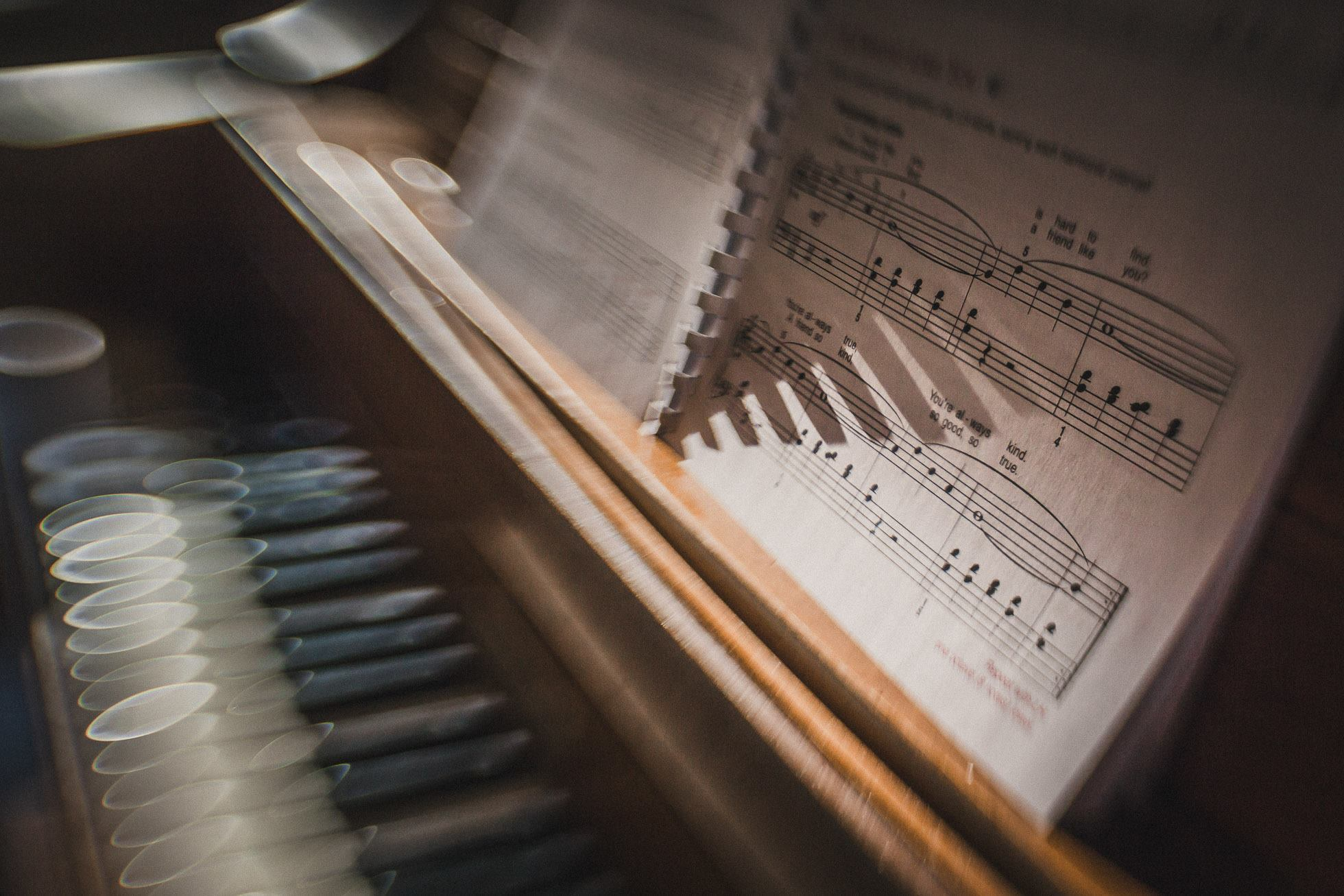 sheet music on a piano long shadows from spiral notebook keys keyboard lensbaby featured photos