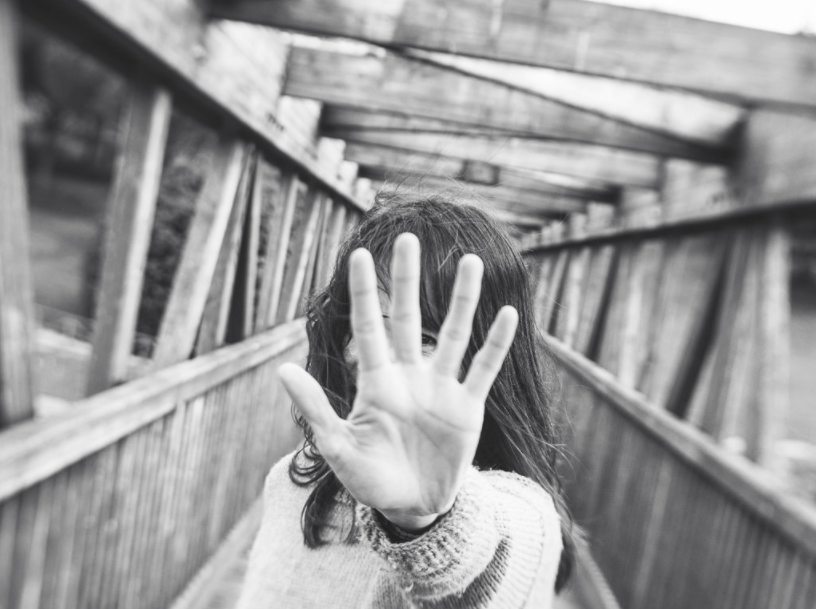 woman with brown hair hand in front of camera wooden bridge five portrait Lensbaby featured photos