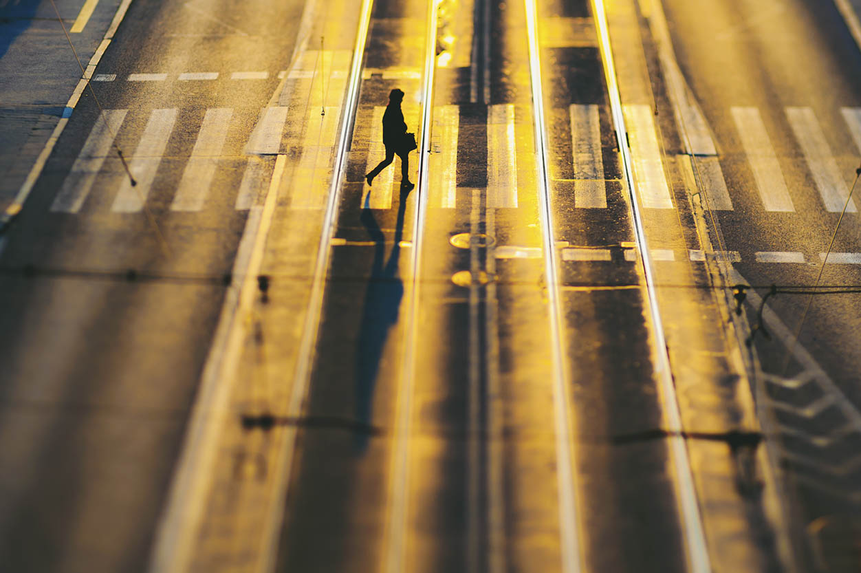 silhouette crossing a crosswalk with a briefcase golden yellow light Lensbaby top 12 photos