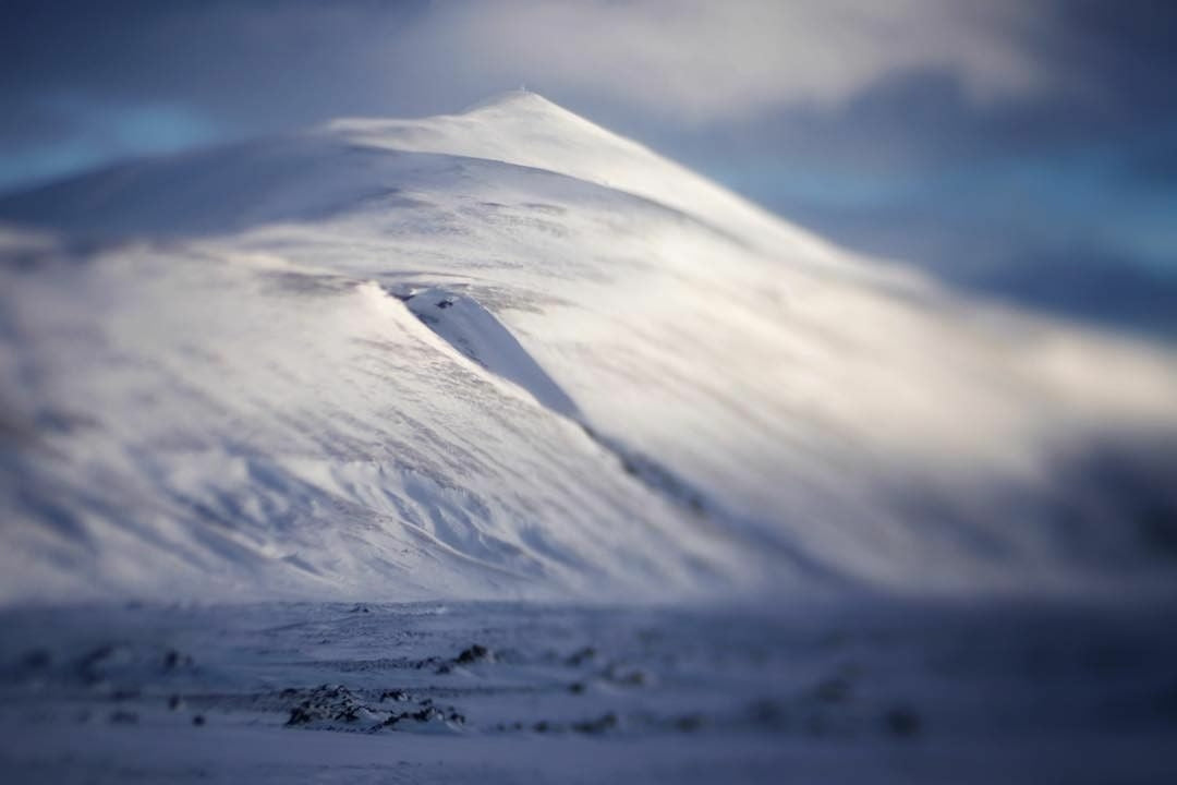 snowy snow steep mountains landscape blue and white soft clouds Lensbaby featured photos