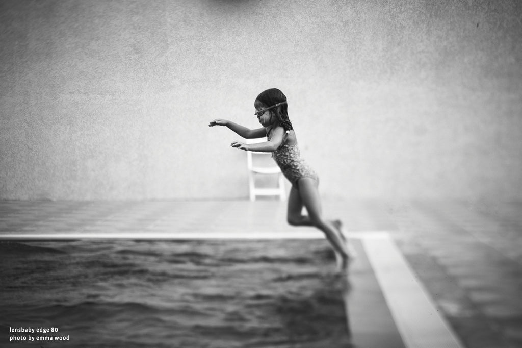 young girl jumping into pool black and white lensbaby manifesto photographs