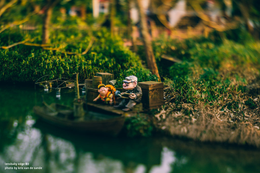 garden gnomes chubby statues sitting in the grass reading books lensbaby university edge