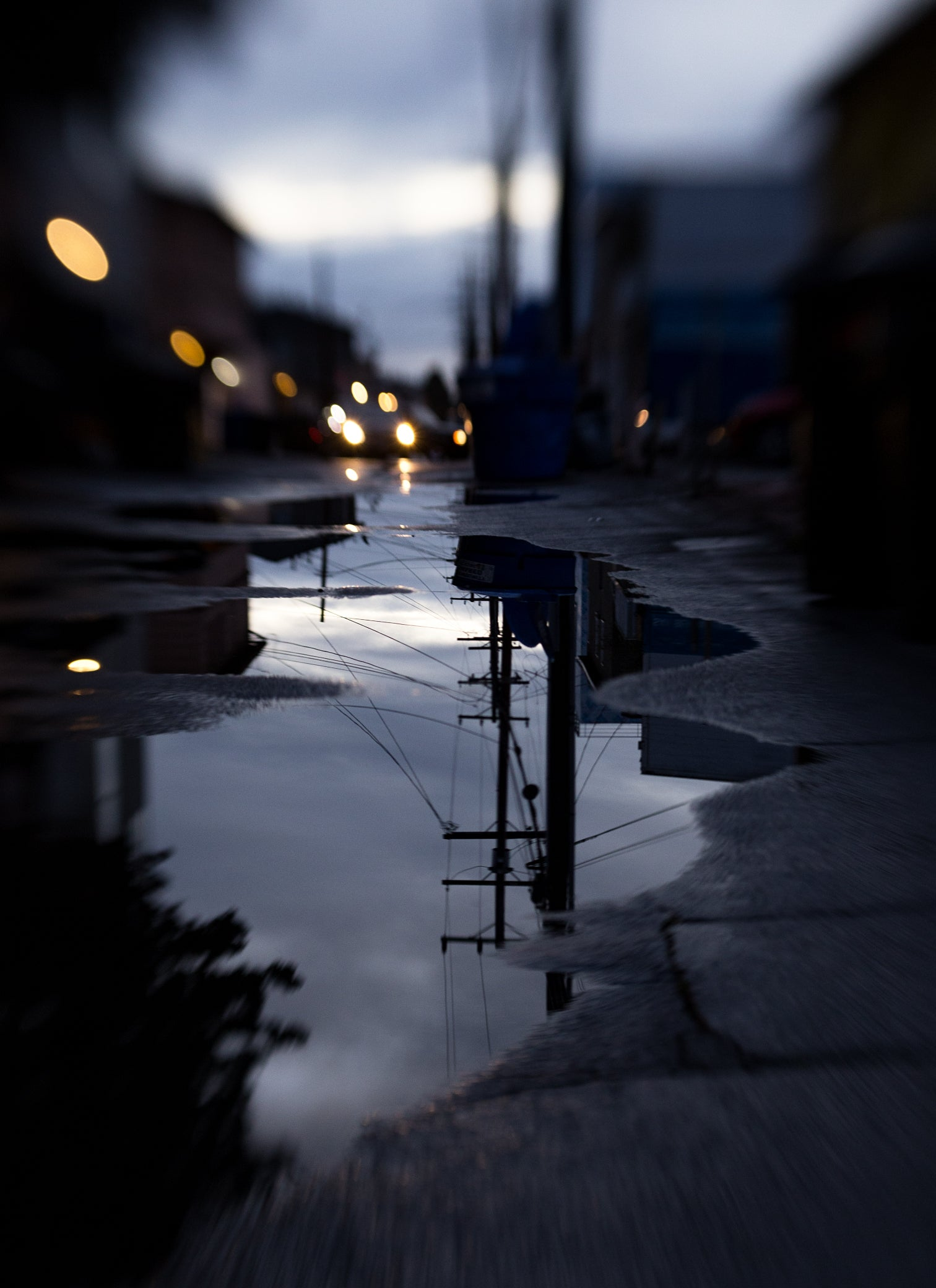 reflection of car lights in a puddle street photography at night dusk bokeh Lensbaby featured photos