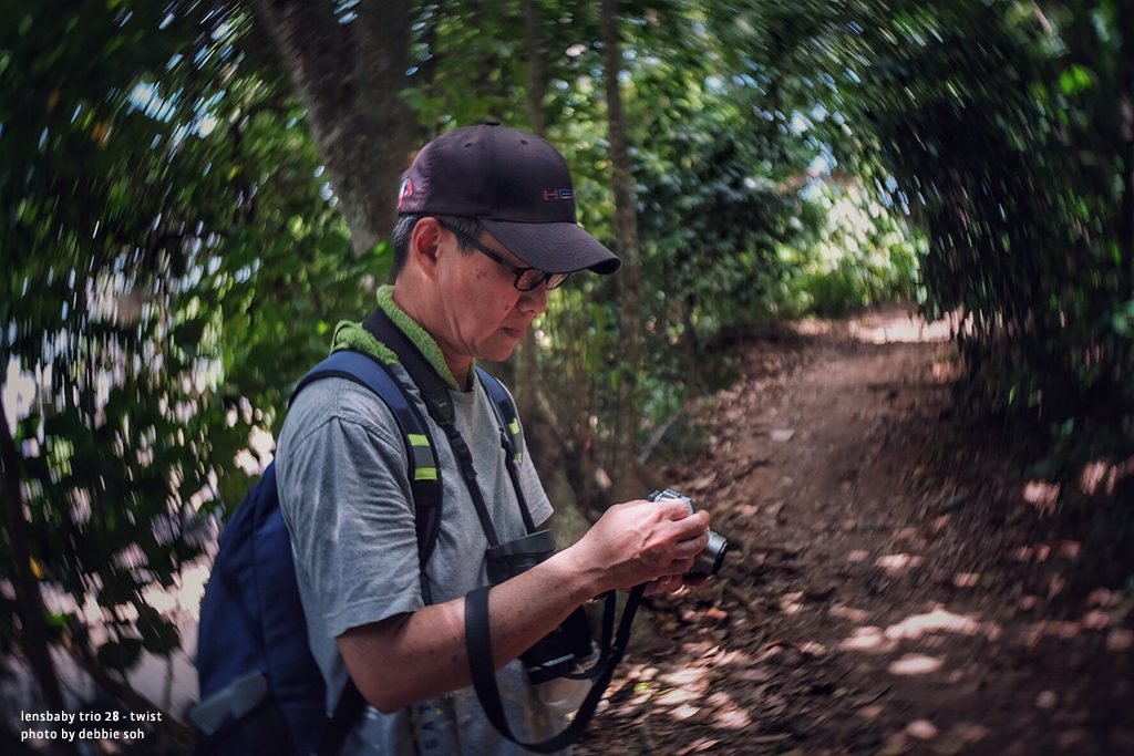 Man with camera on trail through the forest Debbie Soh Trio 28 Lensbaby Creative Photography