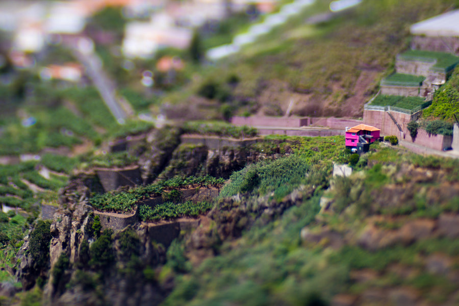 The Edge 80 Optic by Lensbaby allows for beautiful tilt shift lens shots like this one of a mountain terrace garden and a small family house in red and yellow on the hillside.