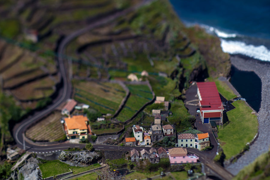 High perspective view of a small coastal town shot in Lensbaby tilt shift lens style with the Edge 80 optic by Nuno Caldeira.