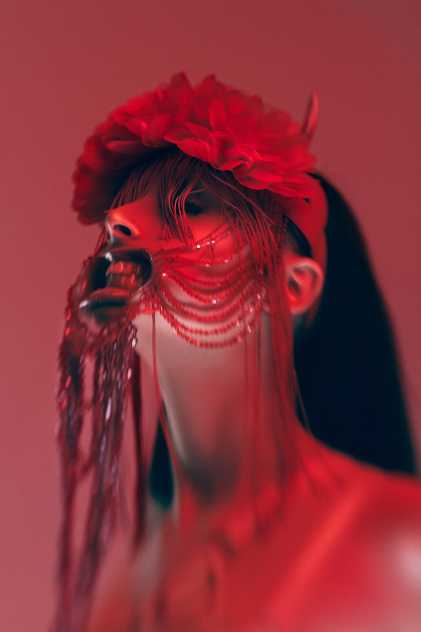 woman with red jewel mask and red lights teeth black hair fashion red light Lensbaby featured photos