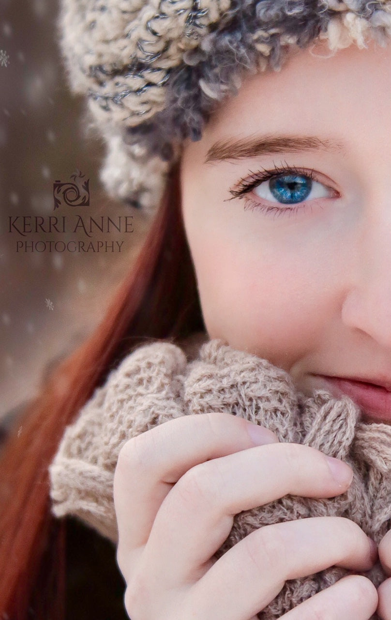 portrait of woman with blue eyes and red hair in winter with hat and gloves Lensbaby featured photos