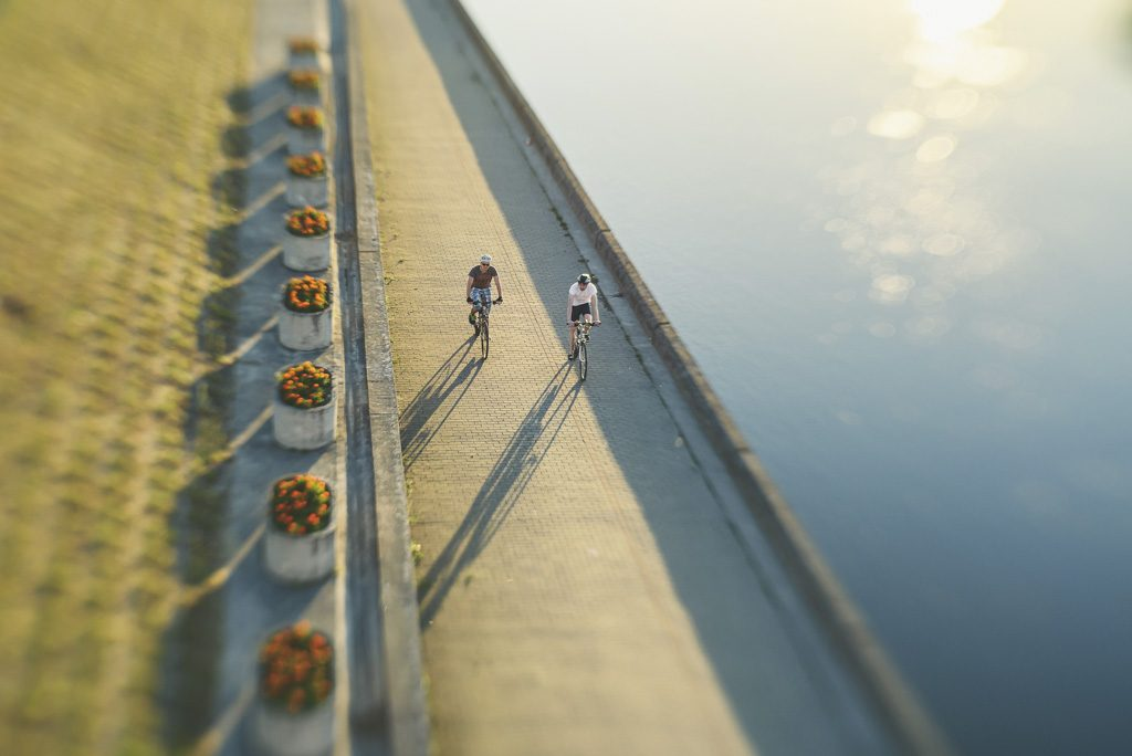 Cyclists next to river