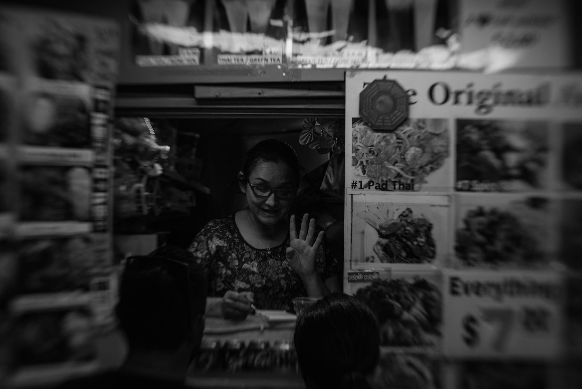 Woman in food truck taking order