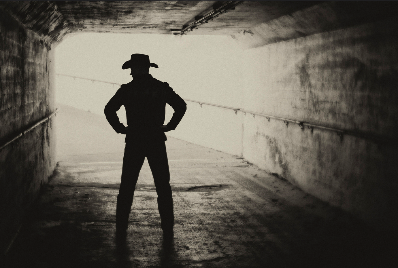 cowboy silhouette standing in tunnel sepia Lensbaby featured photos