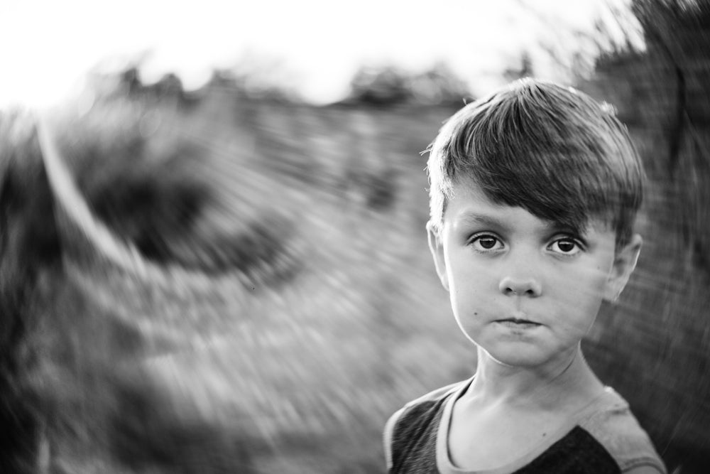boy in black and white looking serious