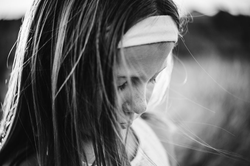 girl with white headband up close black and white