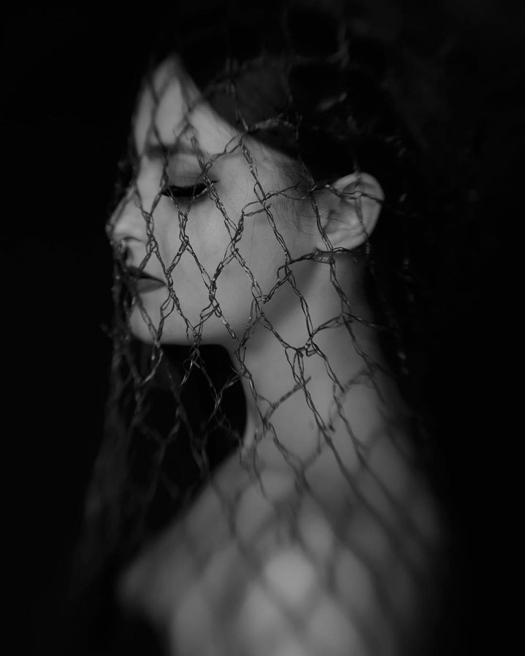 black and white woman with veil chain over her face eyes closed featured photos of the week