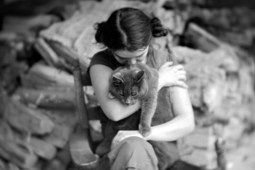 girl with dark hair hugs a cat black and white lensbaby featured photos