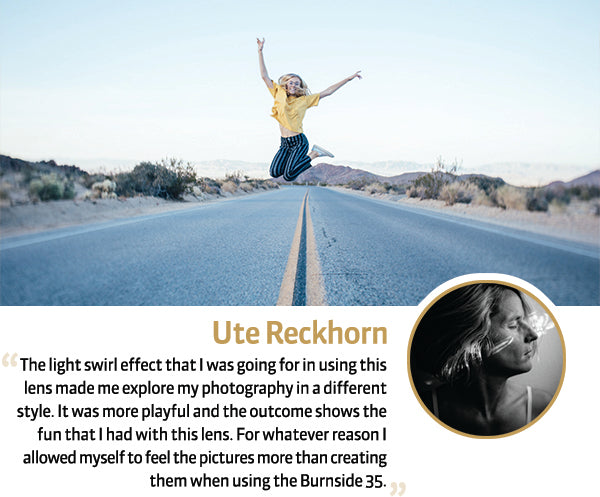 Ute Reckhorn Burnside 35 Quote Girl with Yellow shirt and blue jeans jumps above the yellow stripe in the road
