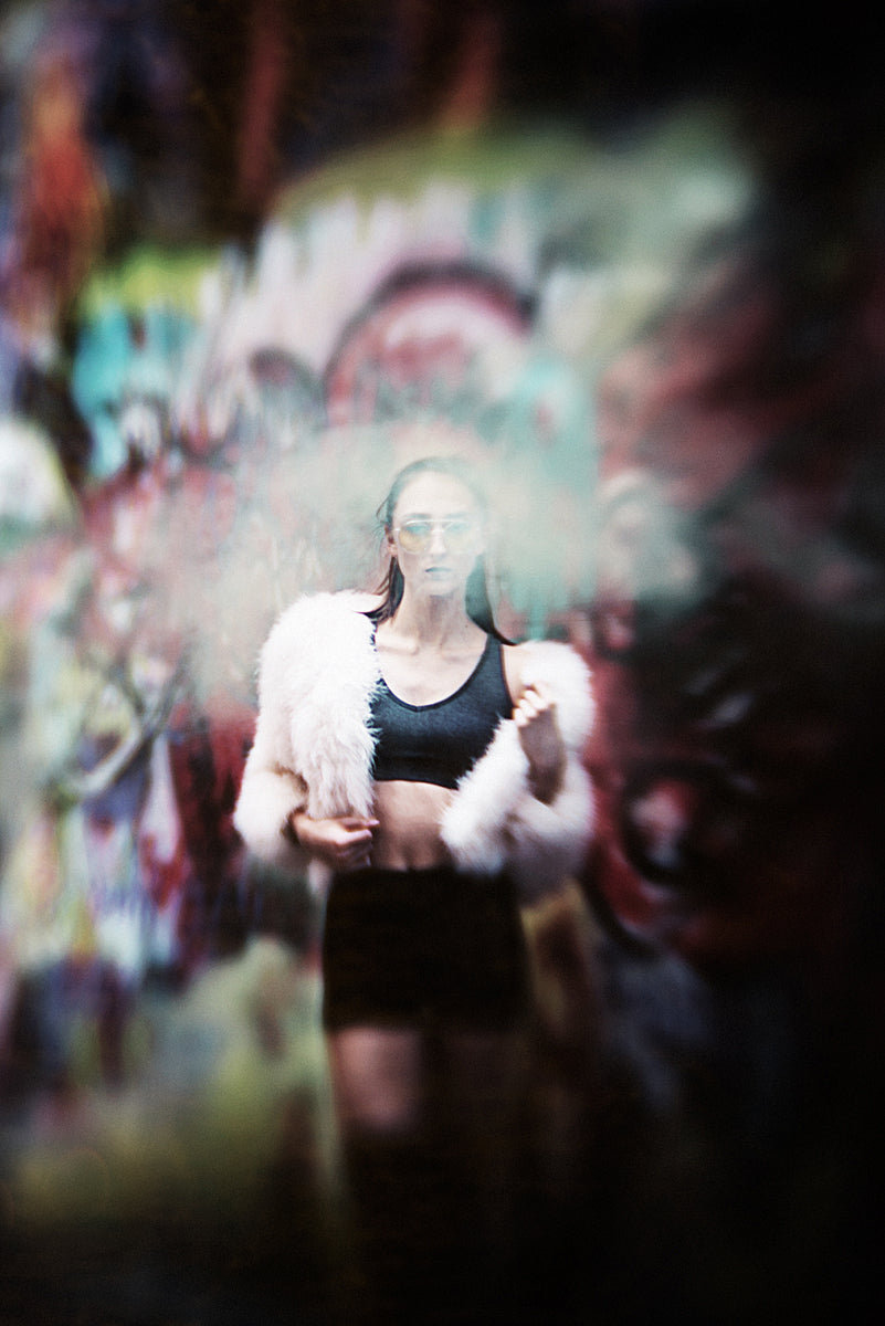 woman with fuzzy white jacket, sunglasses graffiti fashion featured photos of the week we are the enemy of perfection