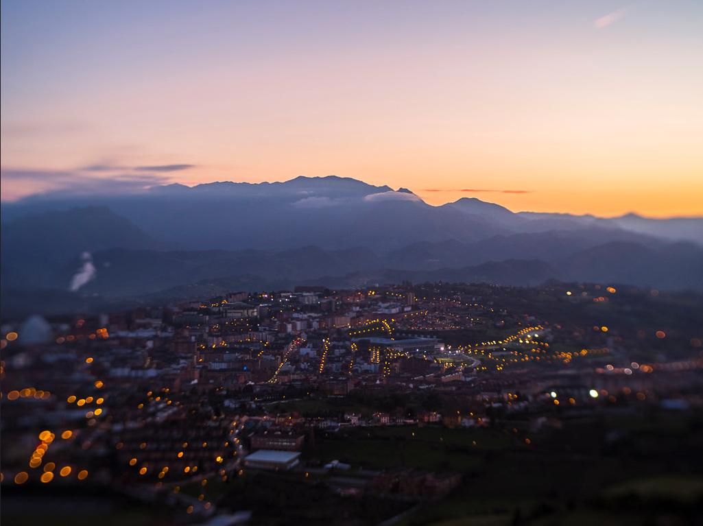 Asturias Spain skyline city lights at sunset whispy clouds Lensbaby featured photos photo challenge