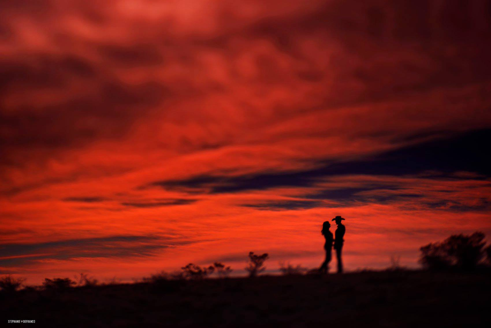 couple silhouette against red sky sunset red and black desert Stephanie DeFranco Lensbaby featured photos of the week