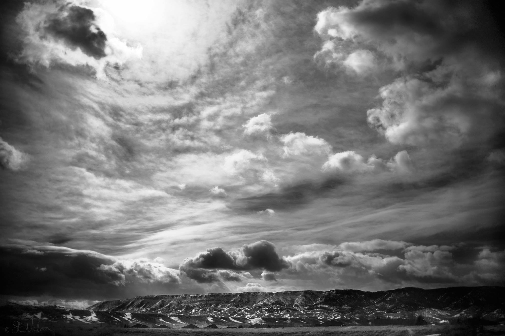 Wyoming landscape moody sky swirling clouds black and white photography lensbaby featured photos