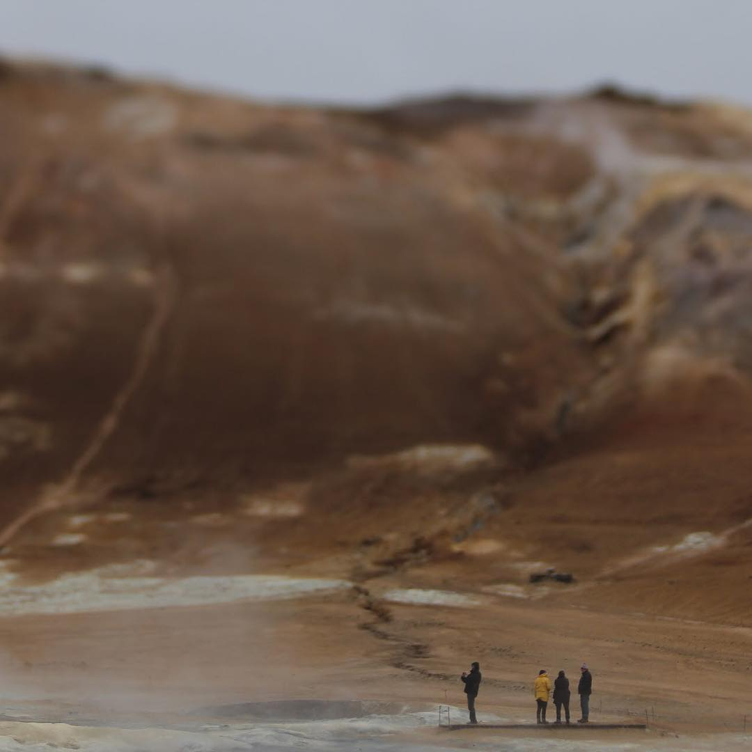Cold winter brown dirt hill small people on a big hill featured photos of the week