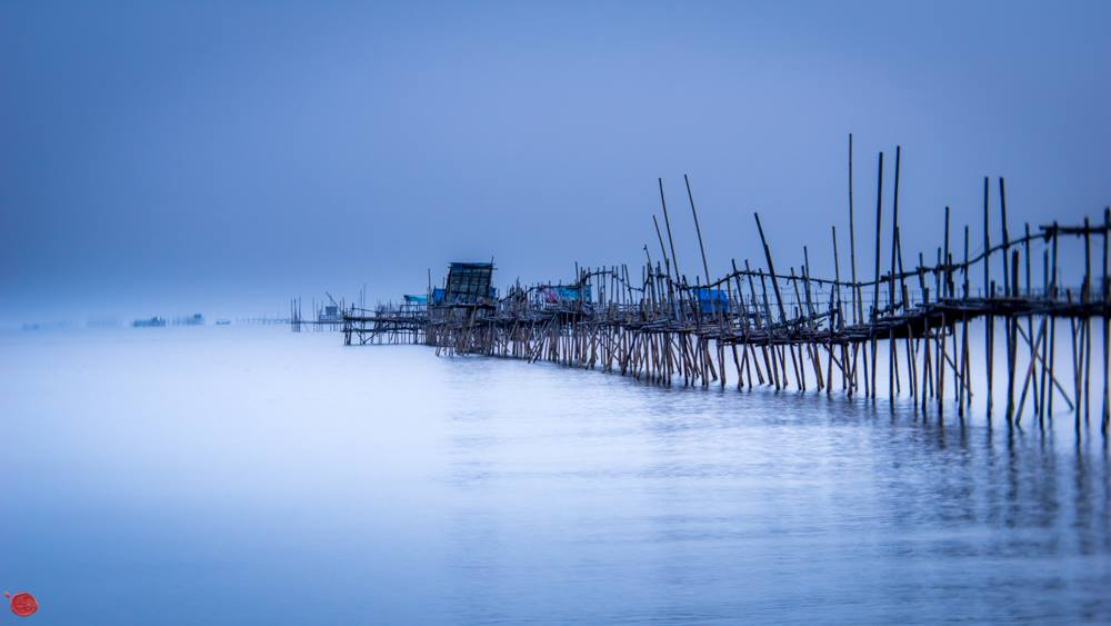 crooked falling down pier blue water blue sky peaceful Lensbaby Top 12 Photos of the Year