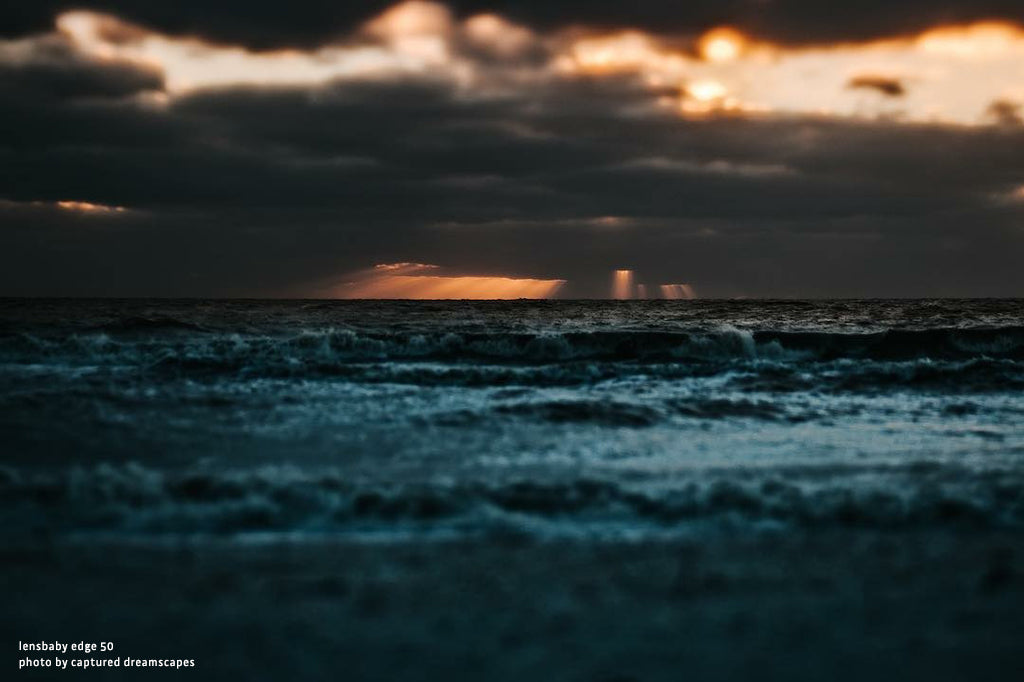 moody ocean at sunset turquoise water dark clouds streaks of light Lensbaby top 12 photos