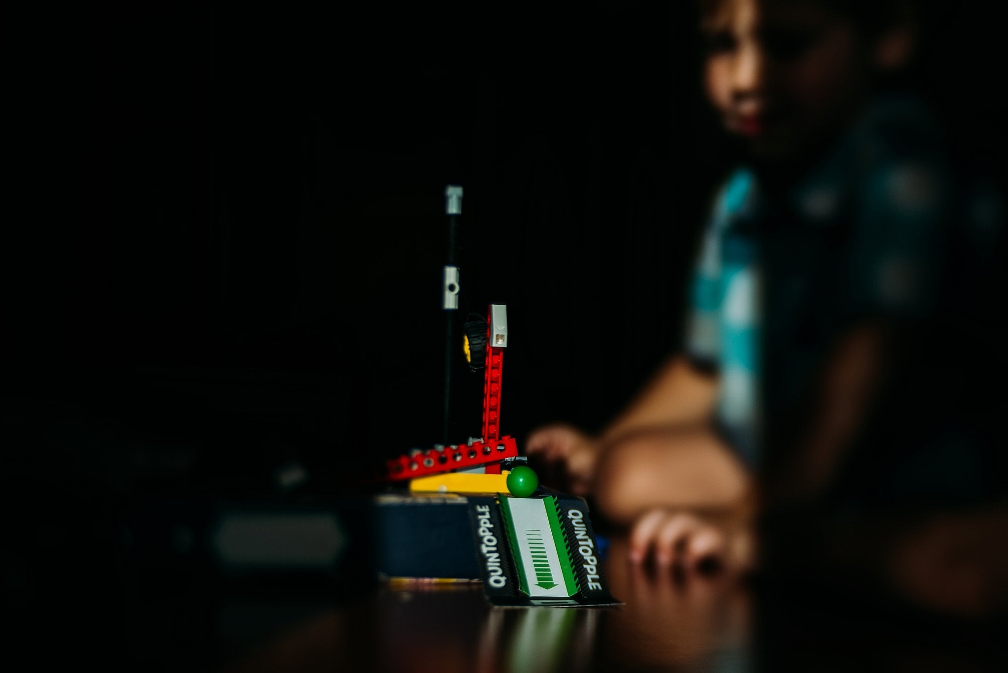 boy playing with legos ramp and green ball light and shadows Chelsea Lyn Lensbaby Challenge
