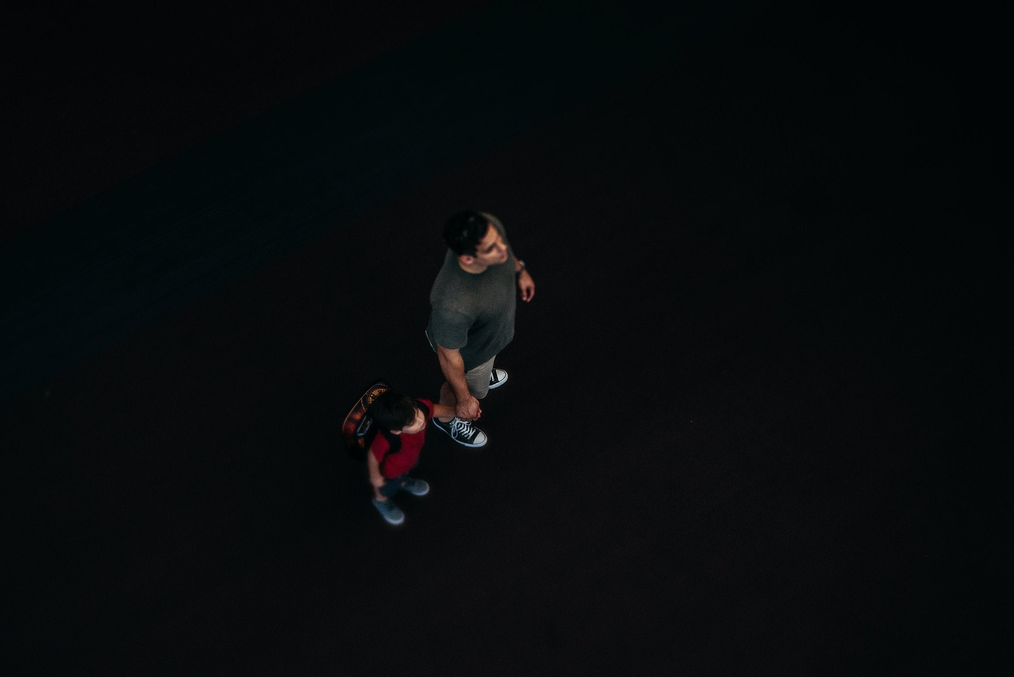 man and boy holding hands view from above looking down dark background Chelsea Lyn Lensbaby Challenge