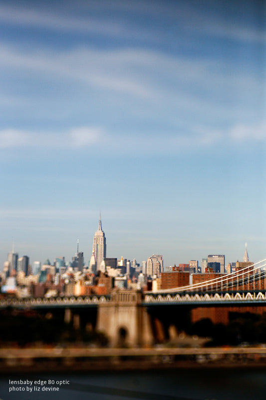 Liz Devine utilizes tilt shift effect with the Edge 80 Optic showing the New York skyline on a blue sky.