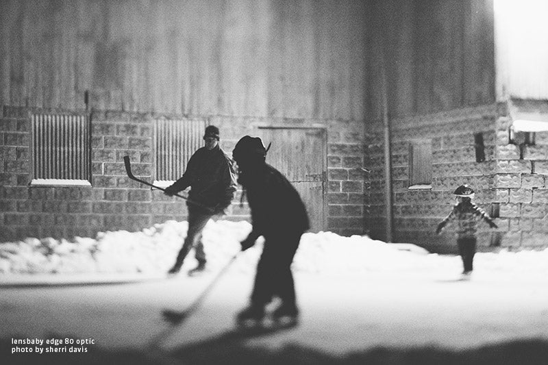 Roller hockey in black and white using tilt shift effect by Sherri Davis.