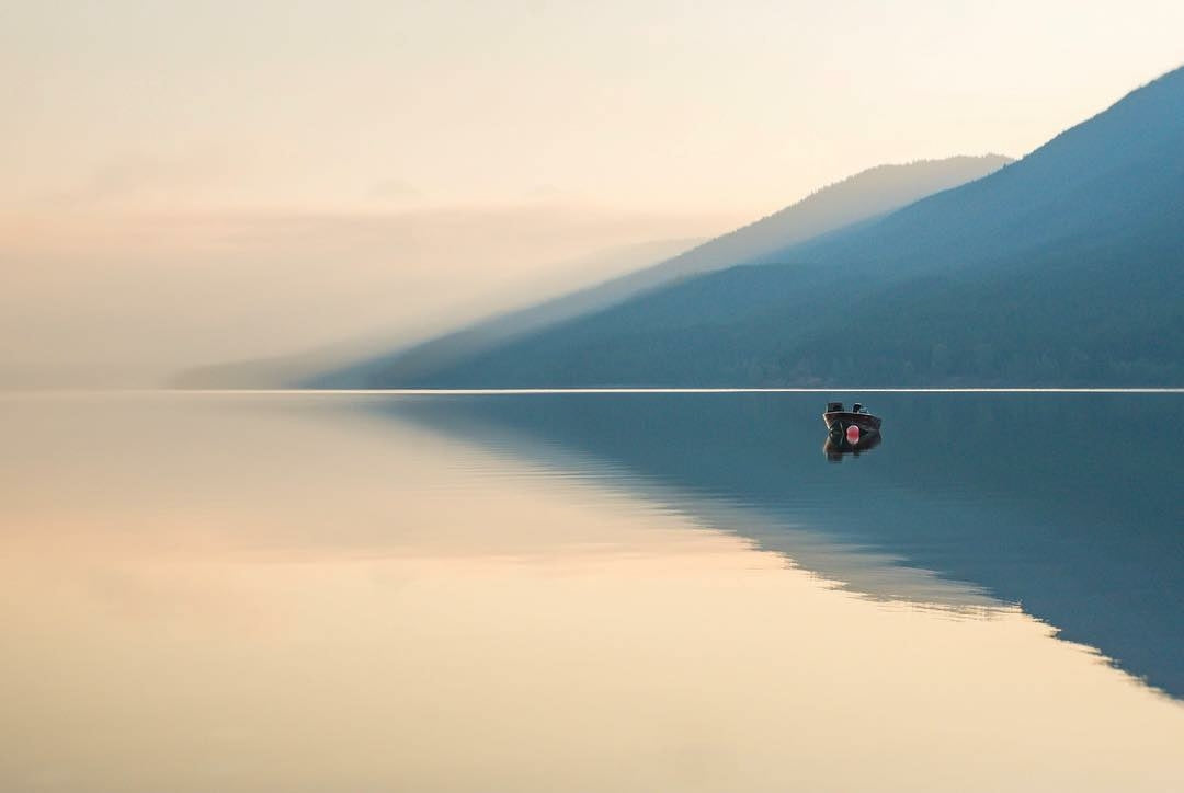 Boat on peaceful water in blue mountains stillness featured photos