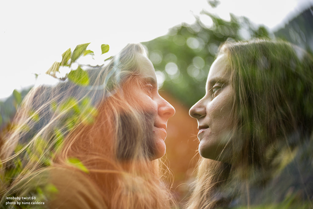 person with long hair triple exposure green leafy background nature lensbaby manifesto struggle