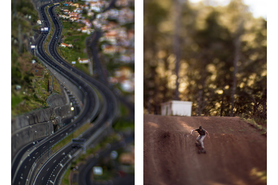 Nuno Caldeira shoots grand tilt shift lens photography using the Lensbaby Edge 80 Optic, the photo on the left is a winding, climbing highway with the focus on the oncoming lane while the right photo shows a skateboarder with oversize wheels headed down a dirt ramp at full speed surrounded by trees bathed in the late summer light.