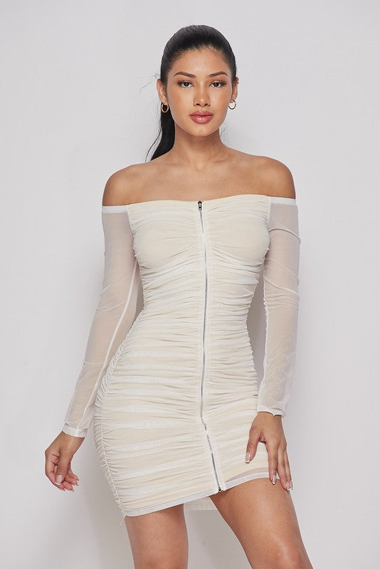 White bodycon dress with long sleeved off the shoulder design