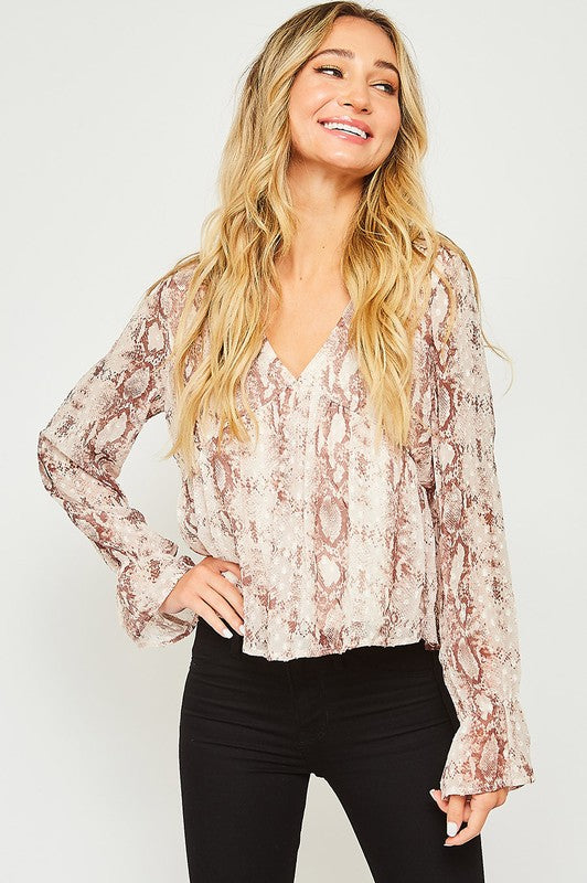 V-neck, animal print blouse, long sleeves with elasticized ruffle-trimmed cuffs.
