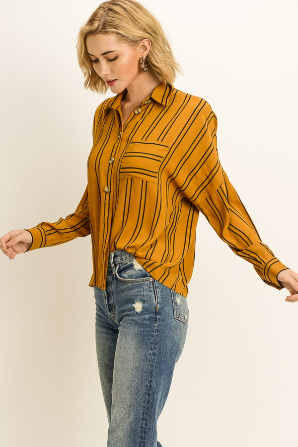 Stripe print long sleeve oversized blouse with button front and collared neckline